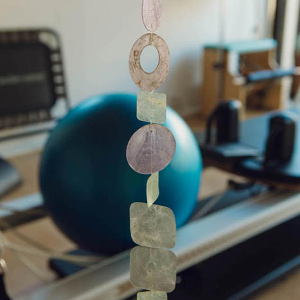 Image of woman strectching in pilates studio